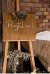 Drewniana tablica powitalna